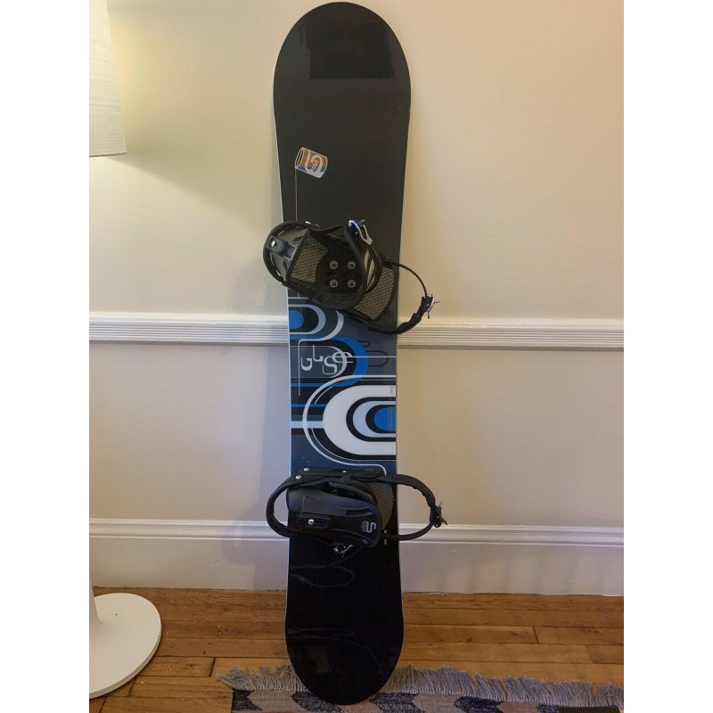 Snowboard With Boots and Bindings (one time use)